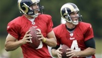 St. Louis Rams quarterbacks Sam Bradford, left, and quarterback A.J. Feeley drop back to pass during NFL football training camp Saturday, July 30, 2011, at the Rams' training facility in St. Louis. (AP Photo/Jeff Roberson)