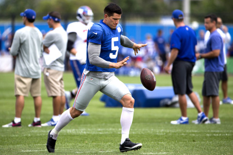 East Rutherford, NJ - July 29: New York Giants training camp at their East Rutherford team training facility. New York Giants punter Steve Weatherford #5 kicks the ball during the workout. July 29, 2014.  (Photo by Anthony Causi)