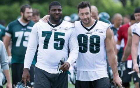 Jun 17, 2015; Philadelphia, PA, USA; Philadelphia Eagles defensive lineman Vinny Curry (75) and linebacker Connor Barwin (98) walk off the field after practice at minicamp at The NovaCare Complex. Mandatory Credit: Bill Streicher-USA TODAY Sports
