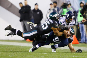 PHILADELPHIA, PA - DECEMBER 07: Quarterback Russell Wilson #3 of the Seattle Seahawks is tackled by Mychal Kendricks #95 and Connor Barwin #98 of the Philadelphia Eagles in the first half of the game at Lincoln Financial Field on December 7, 2014 in Philadelphia, Pennsylvania. (Photo by Al Bello/Getty Images)