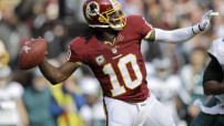 Washington Redskins quarterback Robert Griffin III throws a touchdown pass during the first half of an NFL football game against the Philadelphia Eagles in Landover, Md., Sunday, Nov. 18, 2012. (AP Photo/Patrick Semansky)